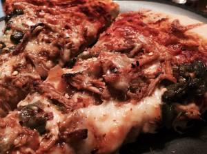 Roasted Poblano Carnitas Pizza slice