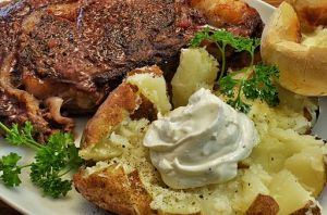 Ribeye_and_baked_potato_(13273850843)
